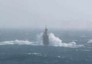 fotos de faro en el mar